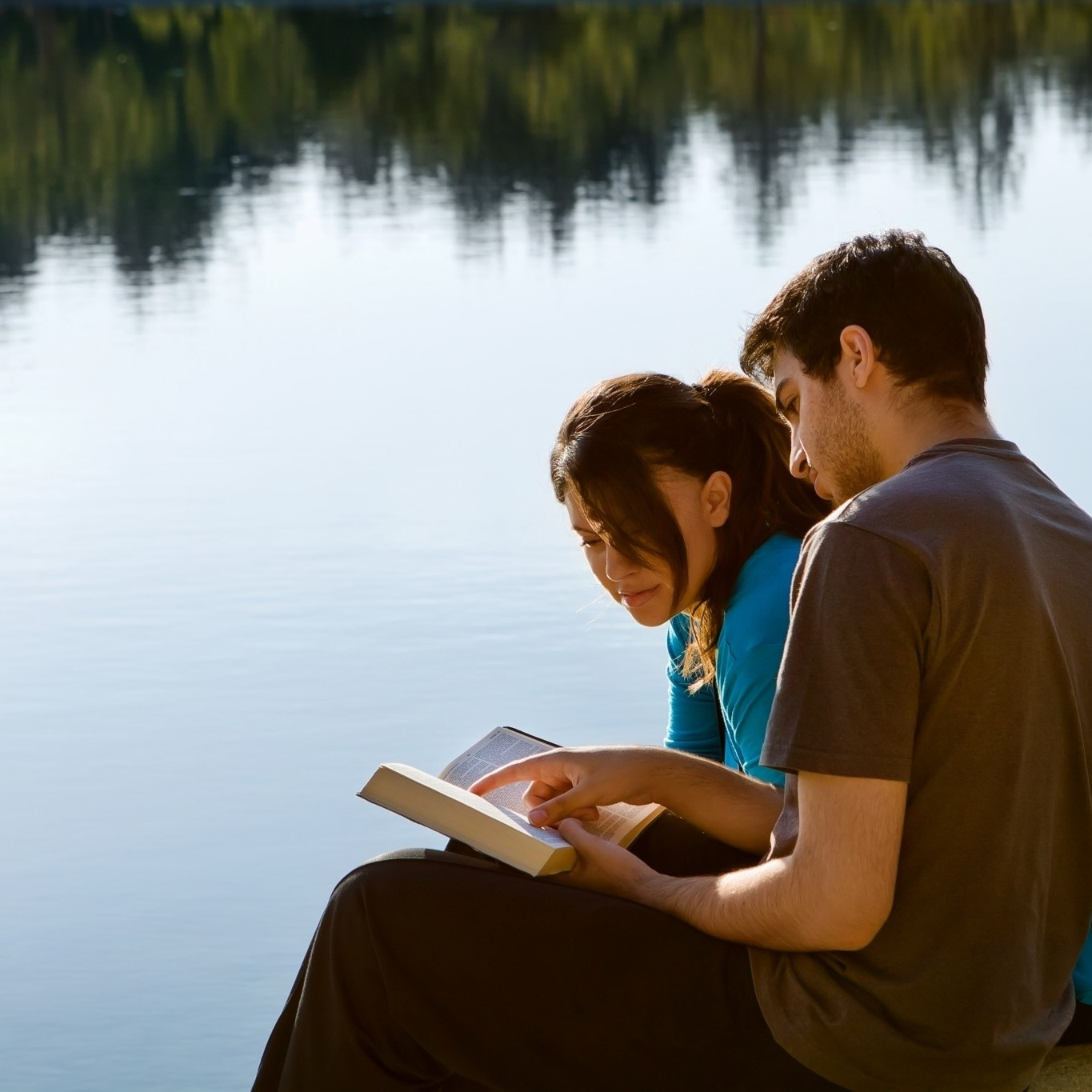 bigstock-Couple-Reading-The-Bible-By-A--45274390